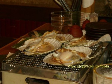 Grilled fresh scallops at Uoichi Syouten in Matsudo